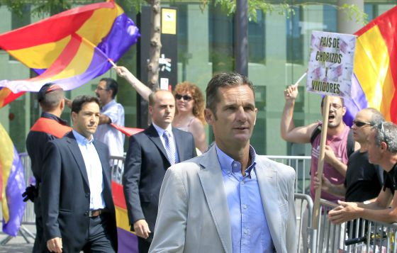 Royal son-in-law Iñaki Urdangarin leaves a Barcelona court on Tuesday after a hearing on a private suit.