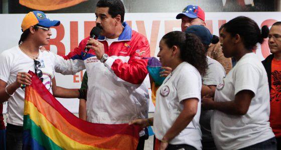 Nicolás Maduro, holding a LGBT flag