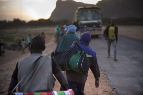 Young Africans trying to make their way to Europe head back on board a bus bound for Gao in Mali after a stop.