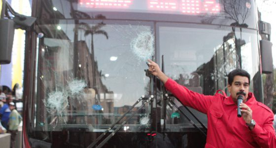Maduro pointing to buses vandalized during the protests.