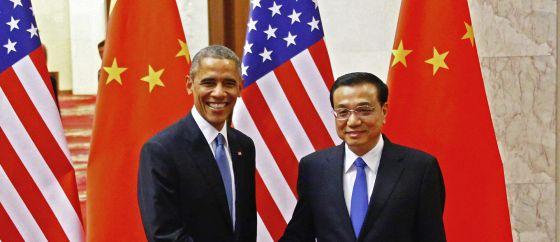 Obama con el primer ministro chino, Li Keqiang, antes de su reunión sobre el cambio climático en Pekín.