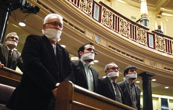 Members of the leftist coalition Izquierda Plural illustrate their opposition to the Citizen Safety Law in Congress.