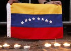 Venezuelan youths march to commemorate 2014 protests