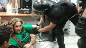 Ada Colau is removed from a bank protest by a police officer. When news broke that she had won the Barcelona mayoral elections, this photo was posted thousands of times on social networking sites such as Twitter.