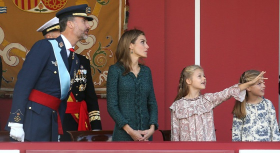 King Felipe, Queen Letizia, the Princess of Asturias and the 'infanta' Sofía during a military parade in October. rn