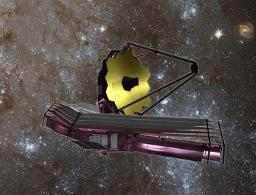 Ilustración del futuro telescopio James Webb desplegado en el espacio.