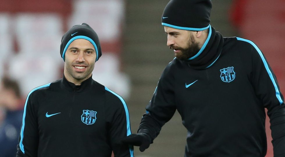 Javier Mascherano y Gerard Piqué.