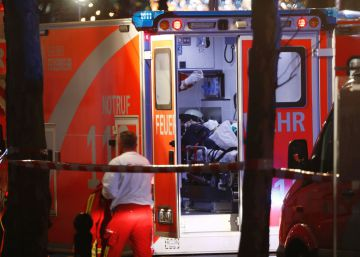 Medics attend to an injured person in an ambulance after a truck crashed into a christmas market at GedxE4chniskirche church in Berlin, on December 19, 2016 killing at least nine people and injuring at least 50 people.  AFP PHOTO  Odd ANDERSEN