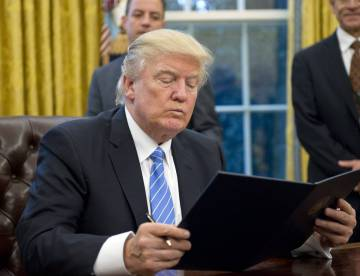 President Donald Trump signing an executive order.