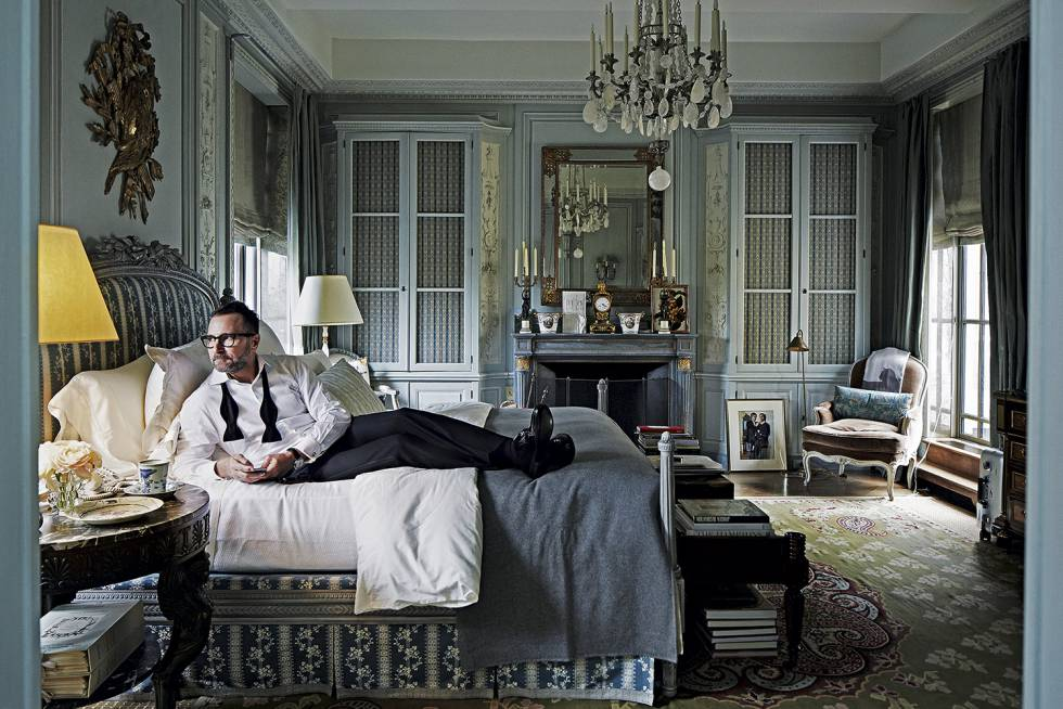 James Costos in the bedroom of his New York attic, located close to Central Park.
