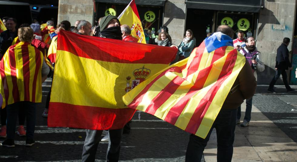 Spanish and Catalan independence flags at a protest in Barcelona.