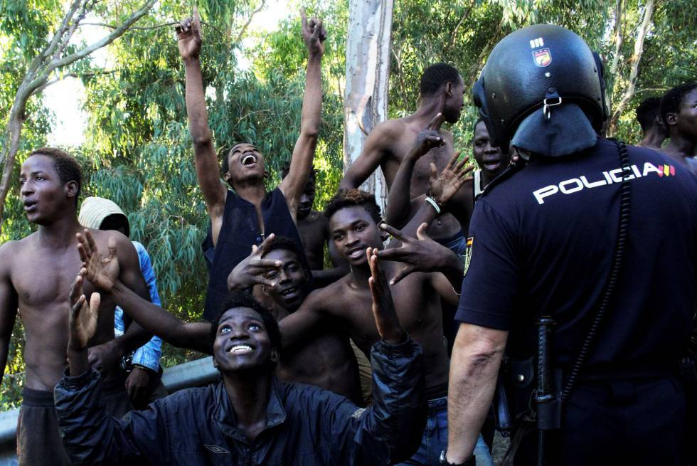 600 migrants storm border and attack security forces to get into Spain