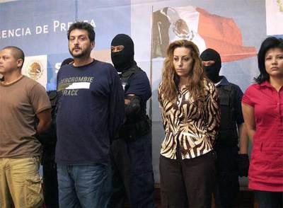 Cuatro presuntos miembros de la célula del Cartel del Golfo desarticulada ayer por la policía mexicana.