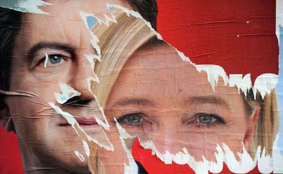 Carteles de Jean-Luc Melenchon y Marine Le Pen.