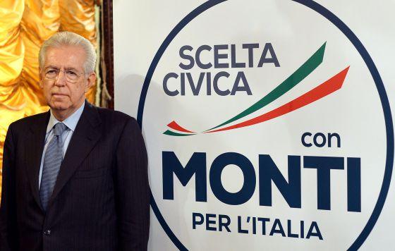 El tecnócrata  Monti posa junto al logo de su nuevo partido este viernes.