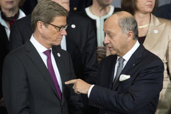 El ministro de Exteriores alemán, Guido Westerwelle (izquierda), y su homólogo francés, Laurent Fabius, este martes en Berlín.