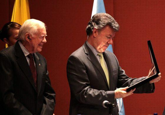 Jimmy Carter y Juan Manuel Santos.