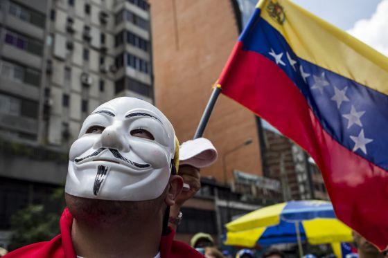 Un manifestante en la marcha de este domingo en Caracas