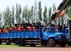 China sentencia en un estadio a 55 personas en Xinjiang