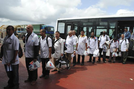 Cuban doctors arrive at the airport in Monrovia, Liberia.