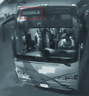 "A still from security footage of the ""fifth bus"" at the main terminal in Iguala on the night of the crime. A few students can be seen inside the vehicle. The image appears in the OAS report but not in the Attorney General's Office files."