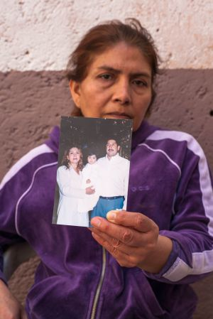Yolanda Guerrero holds a picture of her and her family before the operation.