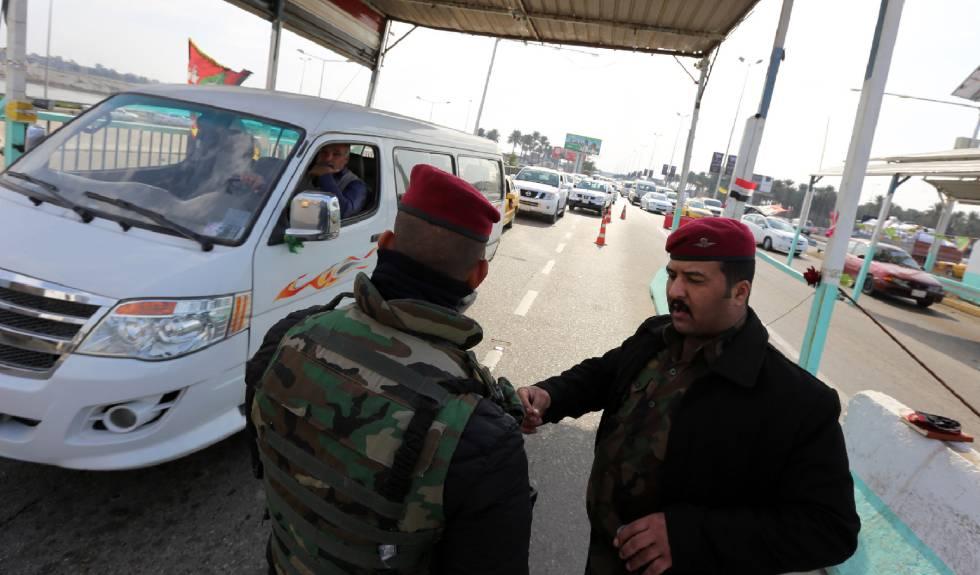 Control de seguridad en el barrio de Dora, en Bagdad.