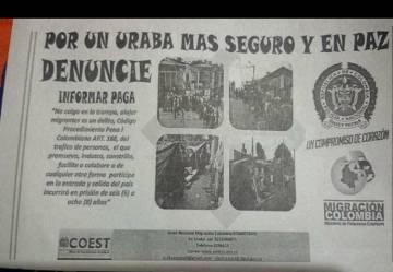 Un planfeto con imágenes del lugar en el que habitan los cubanos en Turbo advierte que es delito alojar migrantes.