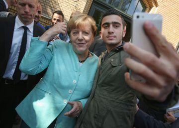 Calumnias ultras contra el sirio del 'selfie' con Merkel