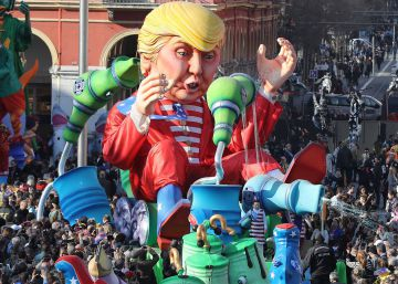 "People look at the float ""Wind of Change"" depicting US President Donald Trump as it parades in the streets of Nice for the 133rd edition of the Nice Carnival on February 19, 2017 in Nice, southeastern France.rn The Nice carnival runs until February 25, 2017 under the theme ""The King of Energies"".   AFP PHOTO  VALERY HACHE"