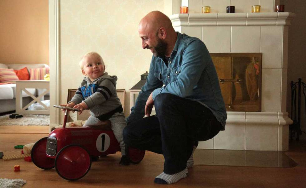 Pablo Capa plays with his 15-month-old son at his house in Kirkkonummi, Finland.