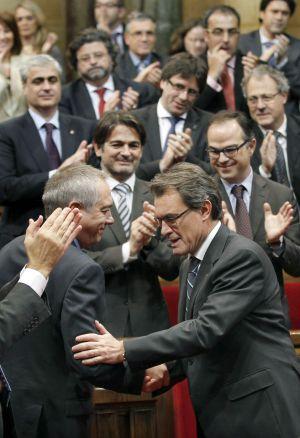 Navarro felicita a Mas tras su investidura.