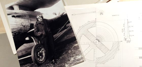 A photo of Captain Leret alongside some of his designs for the first Spanish jet engine.