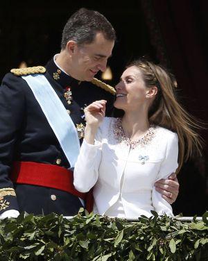 Los Reyes, en el balcón del Palacio Real.