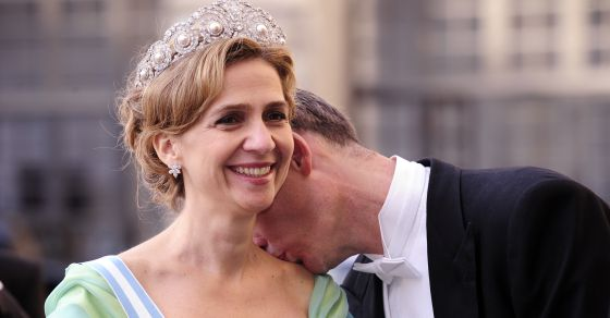 Iñaki Urdangarin kisses his wife Cristina at a royal wedding in Sweden in 2010.