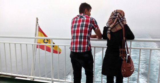 Two Syrian refugees on board a boat headed from Melilla to Malaga.