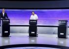 Atril vacío de Rajoy junto al resto de candidatos, durante el debate organizado por EL PAÍS.