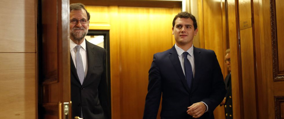 Mariano Rajoy of the Popular Party (left) and Albert Rivera of Ciudadanos.