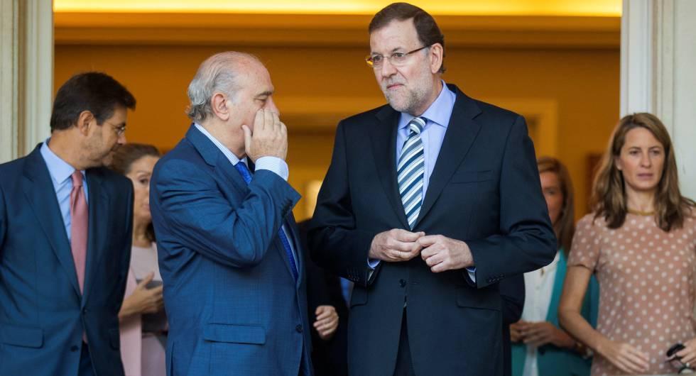 Rajoy y Fernández Díaz en una imagen de octubre de 2014.