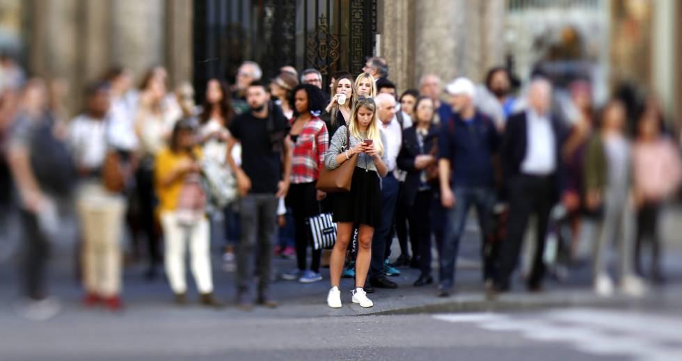 Un grupo de viandantes, en el centro de Madrid.