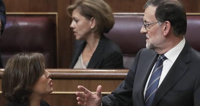 Soraya Saenz de Santamaría, Dolores de Cospedal y Mariano Rajoy durante el pleno de investidura.