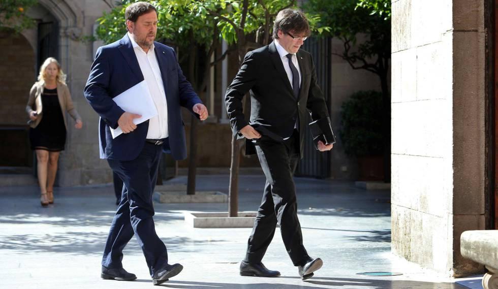 El vicepresidente de la Generalitat, Oriol Junqueras, y el presidente, Carles Puigdemont, este junio.