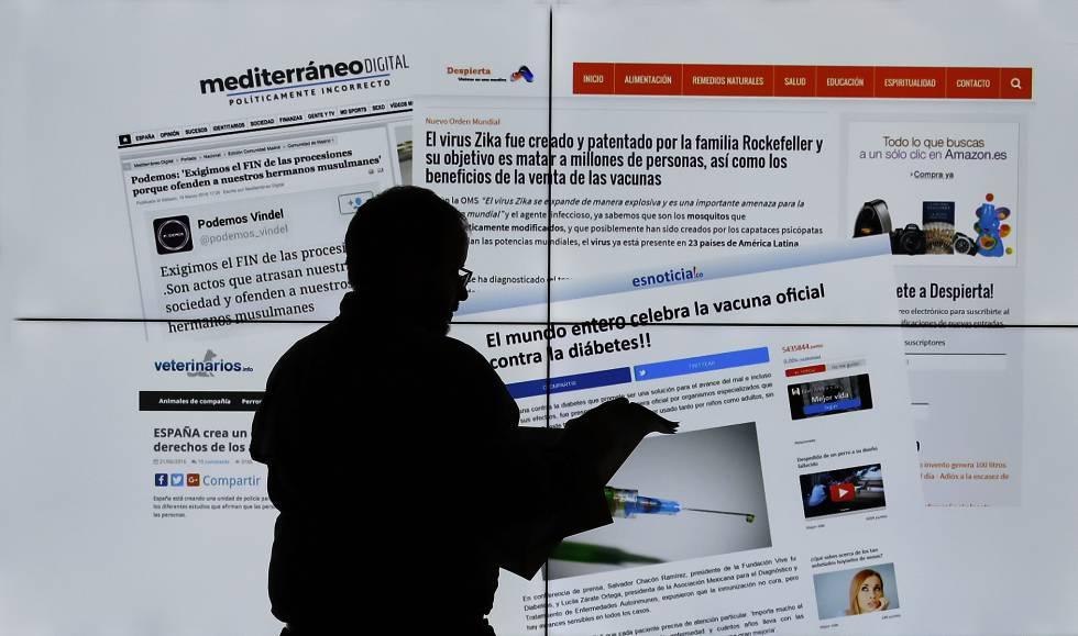 Un hombre observa varias web que muestran noticias falsas recientes