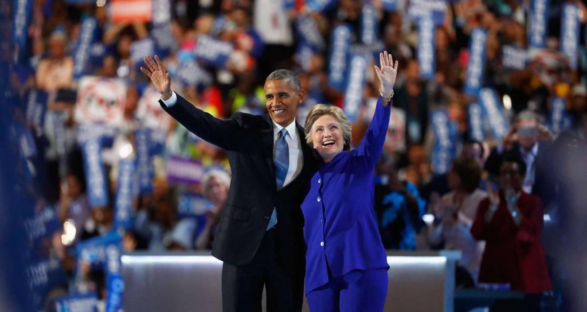 El presidente Obama junto a Clinton, que aspira a sucederle.