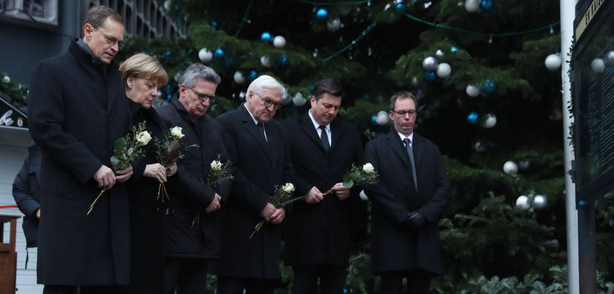 BERLIN, GERMANY - DECEMBER 20: (L-R) Mayor of Berlin, Michael Muller, German Chancellor Angela Merkel, German Interior Minister Thomas de Maiziere and Interior Senator, Andreas Geisel lay flowers near where yesterday a lorry ploughed through a Christmas market on December 20, 2016 in Berlin, Germany. So far 12 people are confirmed dead and 45 injured. Authorities have confirmed they believe the incident was an attack and have arrested a Pakistani man who they believe was the driver of the truck and who had fled immediately after the attack. Among the dead are a Polish man who was found on the passenger seat of the truck. Police are investigating the possibility that the truck, which belongs to a Polish trucking company, was stolen yesterday morning. (Photo by Sean GallupGetty Images)