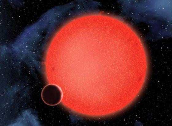 Ilustración del planeta de agua GJ1214b pasando por delante de su estrella.