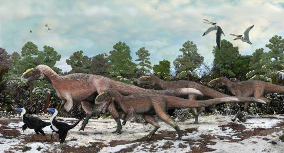 Ilustración de varios ejemplares de 'Yutyrannus huali', un gran dinosaurio con plumas.rn rn
