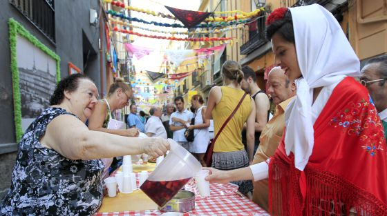 A woman serves sangría during Madrid's San Cayetano festivities.