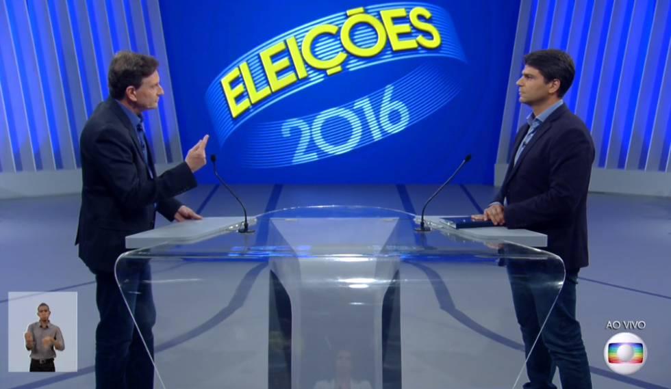 RJ  Freixo e Pedro Paulo polarizam o debate na TV Globo em busca do ... 155819302b189