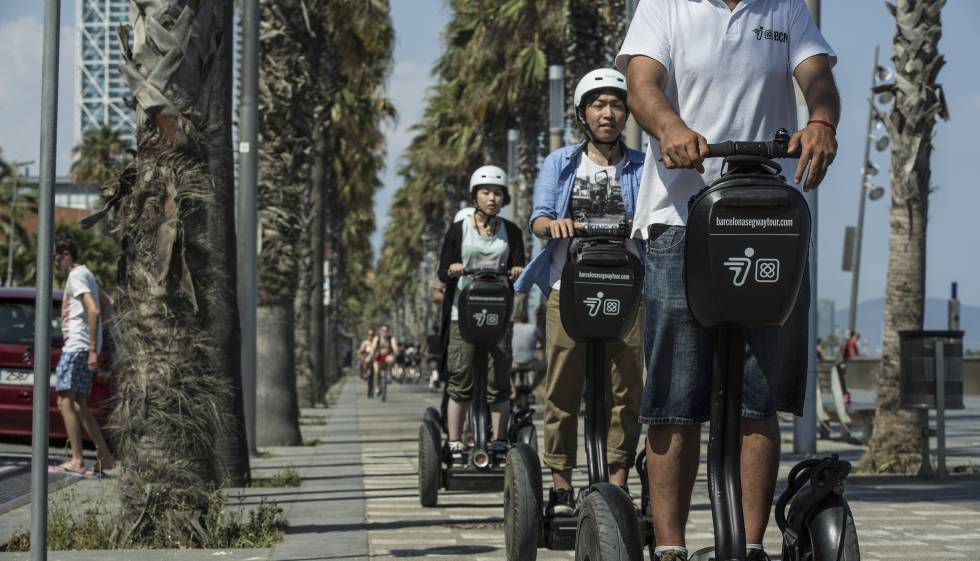 Tourists on a segway tour of Barcelona.